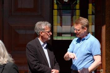 Two parishioners in conversation.