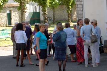 Parishioners having biscuits and coffee after church